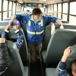 Bus driver Helen Peterson leads students through an earthquake safety drill